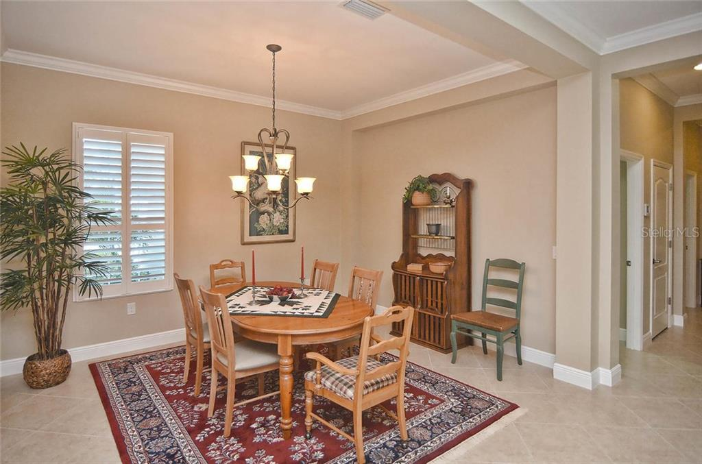Dining room - Single Family Home for sale at 293 Marsh Creek Rd, Venice, FL 34292 - MLS Number is N5914238