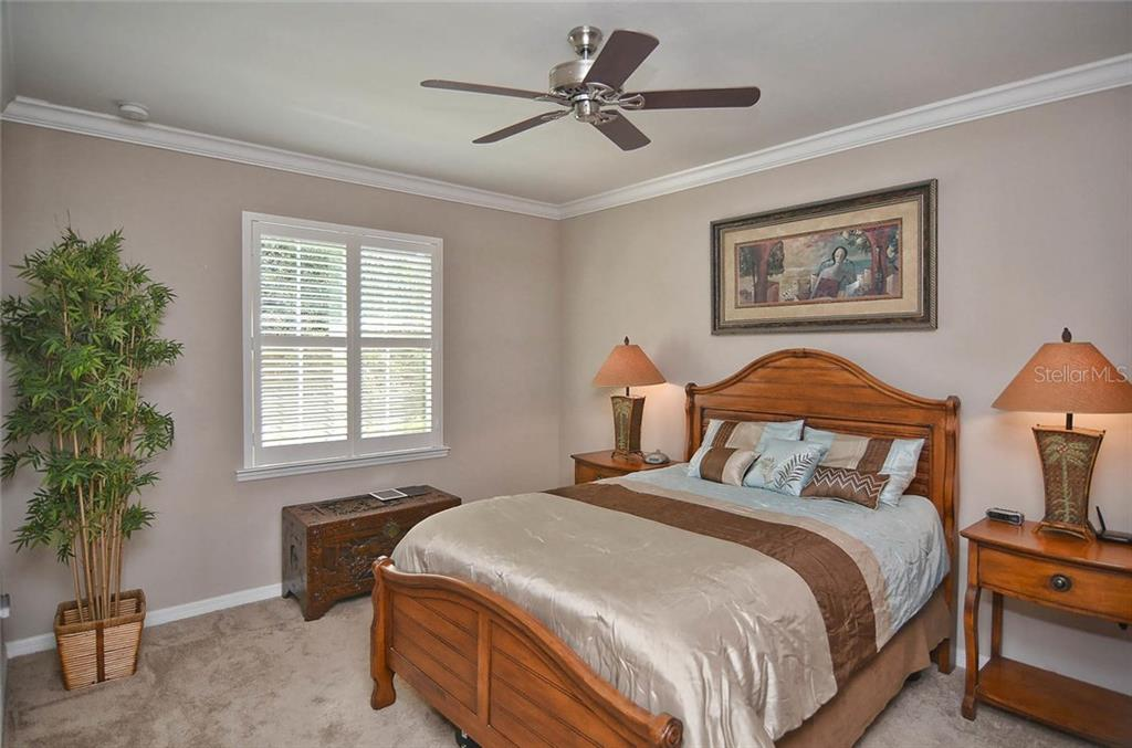 Master bedroom - Single Family Home for sale at 9124 Coachman Dr, Venice, FL 34293 - MLS Number is N5914408
