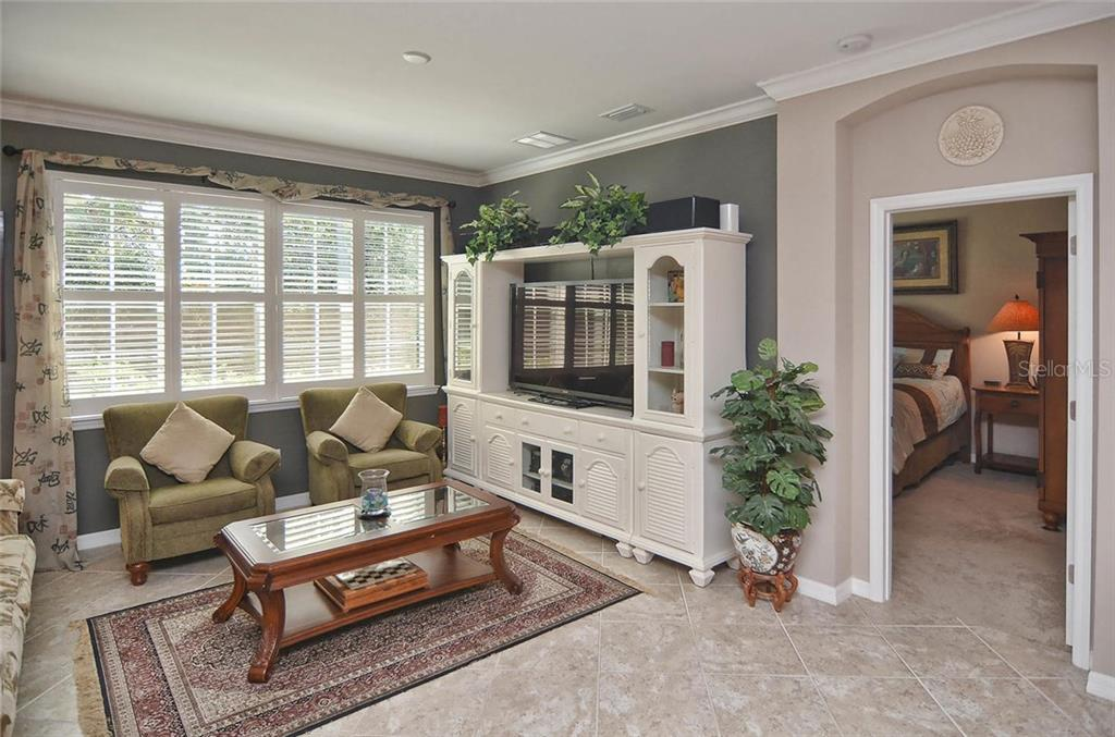 Living room to master bedroom - Single Family Home for sale at 9124 Coachman Dr, Venice, FL 34293 - MLS Number is N5914408