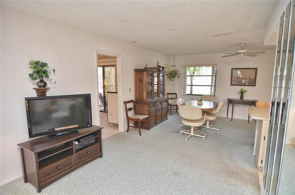 Living room to dining room - Single Family Home for sale at 1410 Strada D Argento, Venice, FL 34292 - MLS Number is N5914540