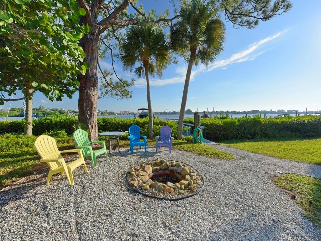 Enjoy a crackling fire while watching the sunset create an amazing masterpiece in the sky. - Single Family Home for sale at 200 Sunrise Dr, Nokomis, FL 34275 - MLS Number is N5914820