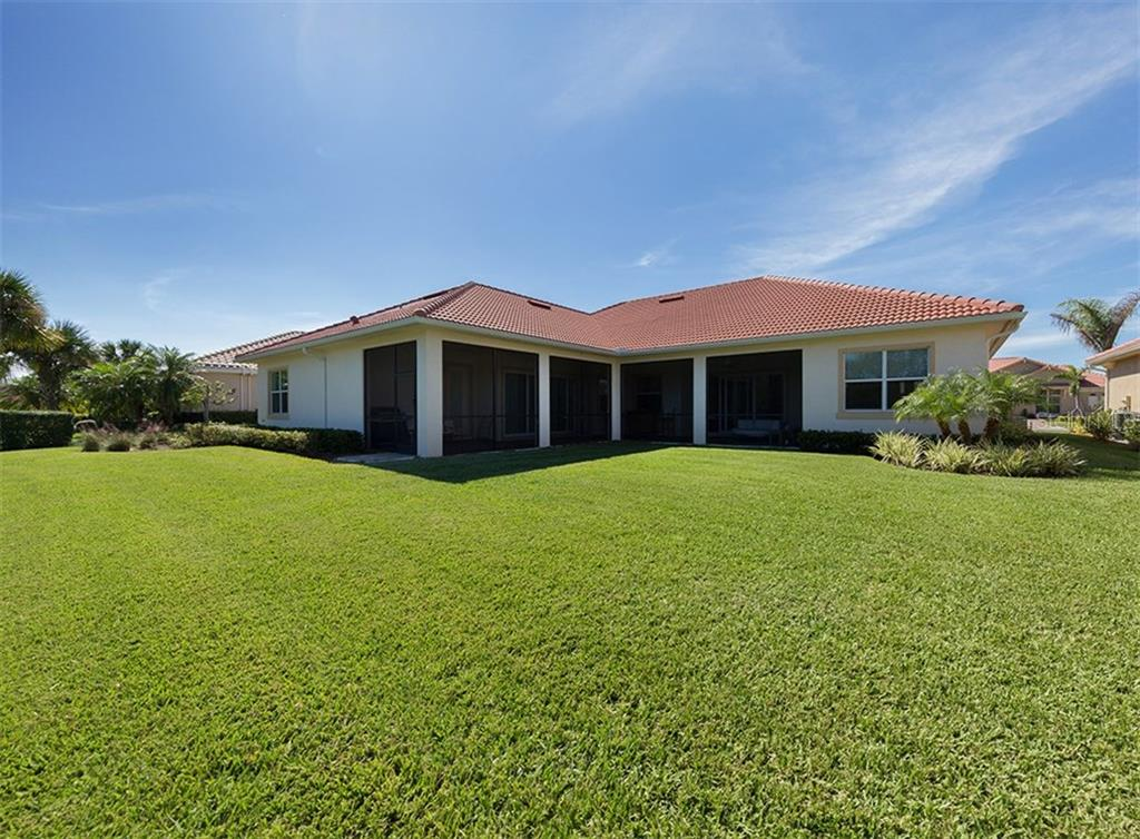 Rear exterior - Single Family Home for sale at 221 Portofino Dr, North Venice, FL 34275 - MLS Number is N5914925