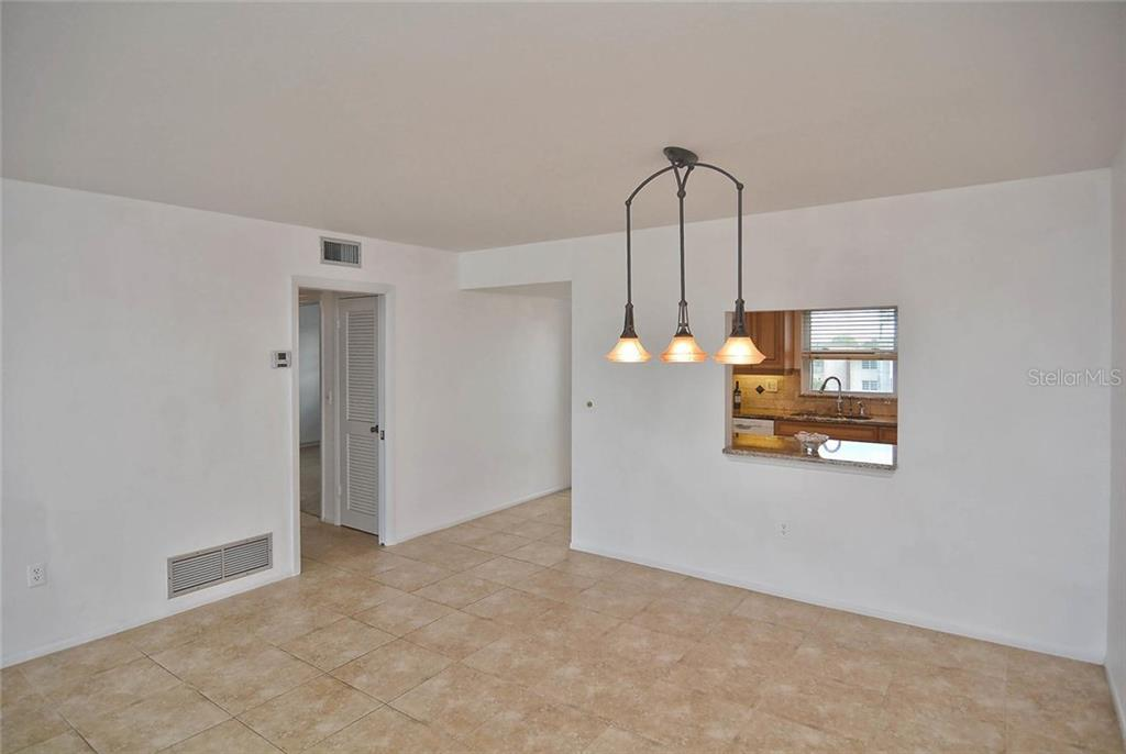 Dining room to kitchen, foyer and bedroom. - Condo for sale at 333 The Esplanade N #402, Venice, FL 34285 - MLS Number is N5914981