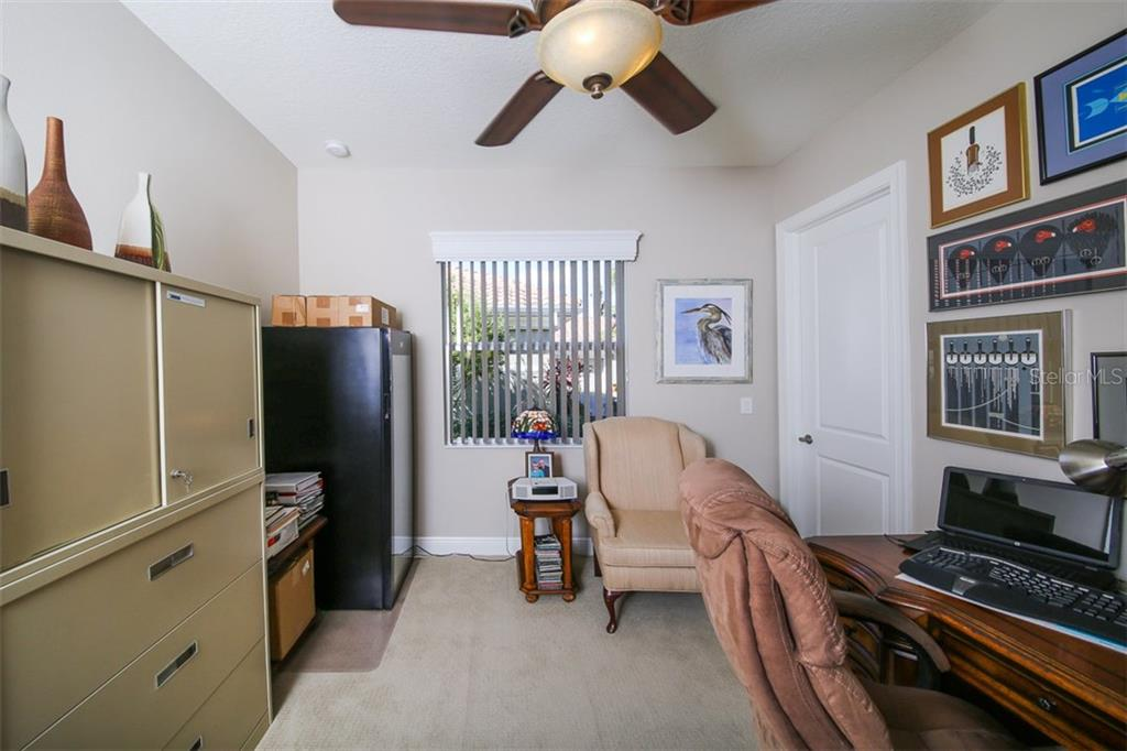 Bedroom 4 serves as a 2nd office with a walk-in closet. - Single Family Home for sale at 190 Portofino Dr, North Venice, FL 34275 - MLS Number is N5915077