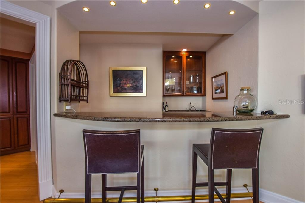 Wet bar in the game room - Single Family Home for sale at 338 W Bay Dr, Venice, FL 34285 - MLS Number is N5915216