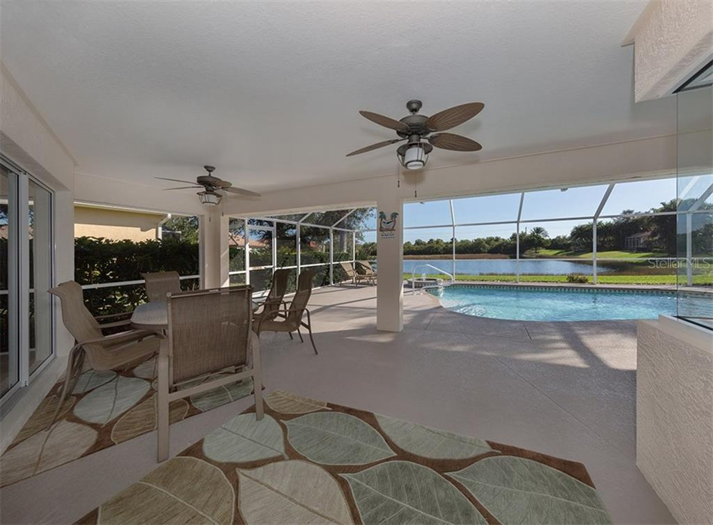 Lanai/pool with view of lake - Single Family Home for sale at 866 Wood Sorrel Ln, Venice, FL 34293 - MLS Number is N5915362