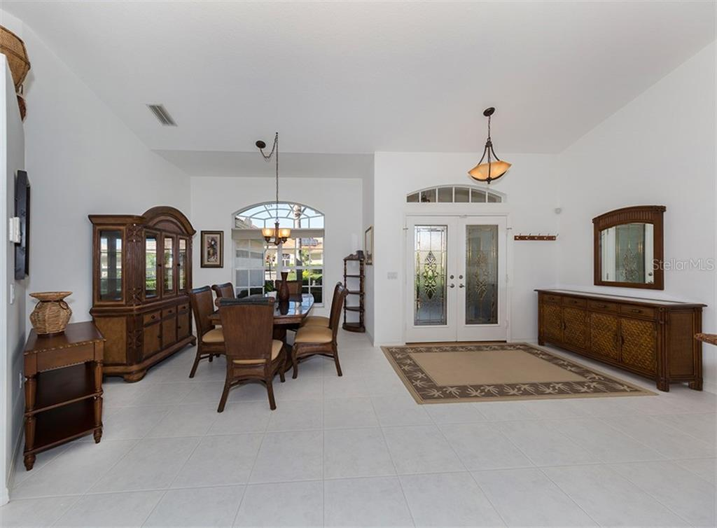 Dining room, foyer - Single Family Home for sale at 866 Wood Sorrel Ln, Venice, FL 34293 - MLS Number is N5915362