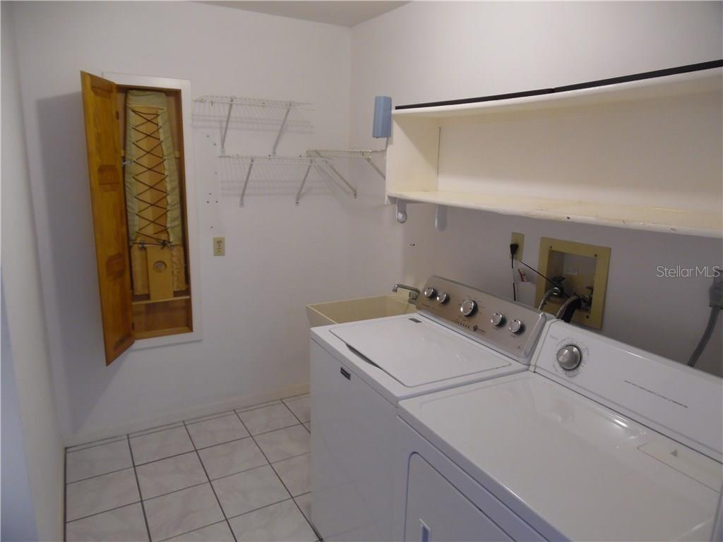 inside utility room with laundry tub and ironing board - Single Family Home for sale at 441 Baynard Dr, Venice, FL 34285 - MLS Number is N5915507