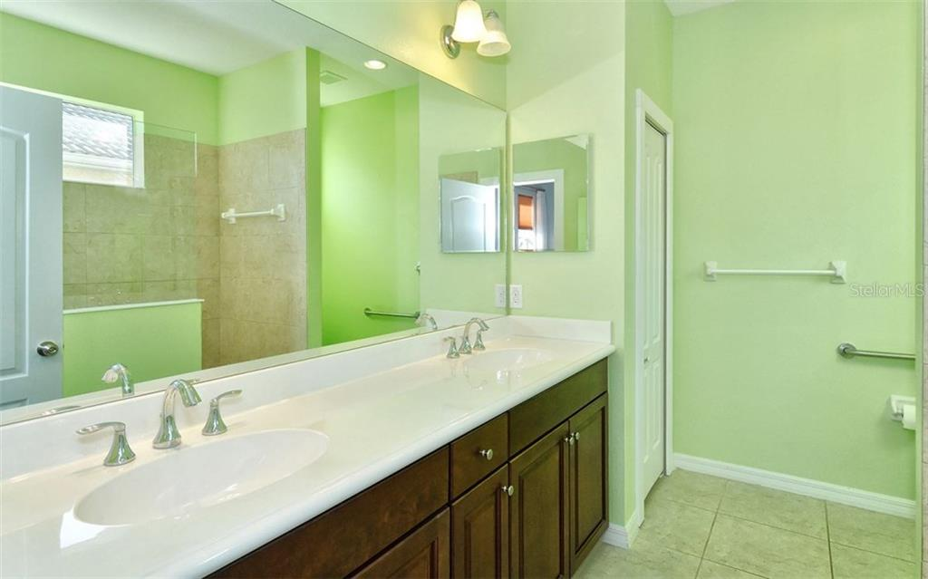 Master Bath - Villa for sale at 10889 Lerwick Cir, Englewood, FL 34223 - MLS Number is N5916198