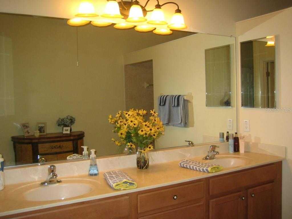 Master bath, dual sinks, Roman shower - Villa for sale at 1445 Maseno Dr, Venice, FL 34292 - MLS Number is N5916837