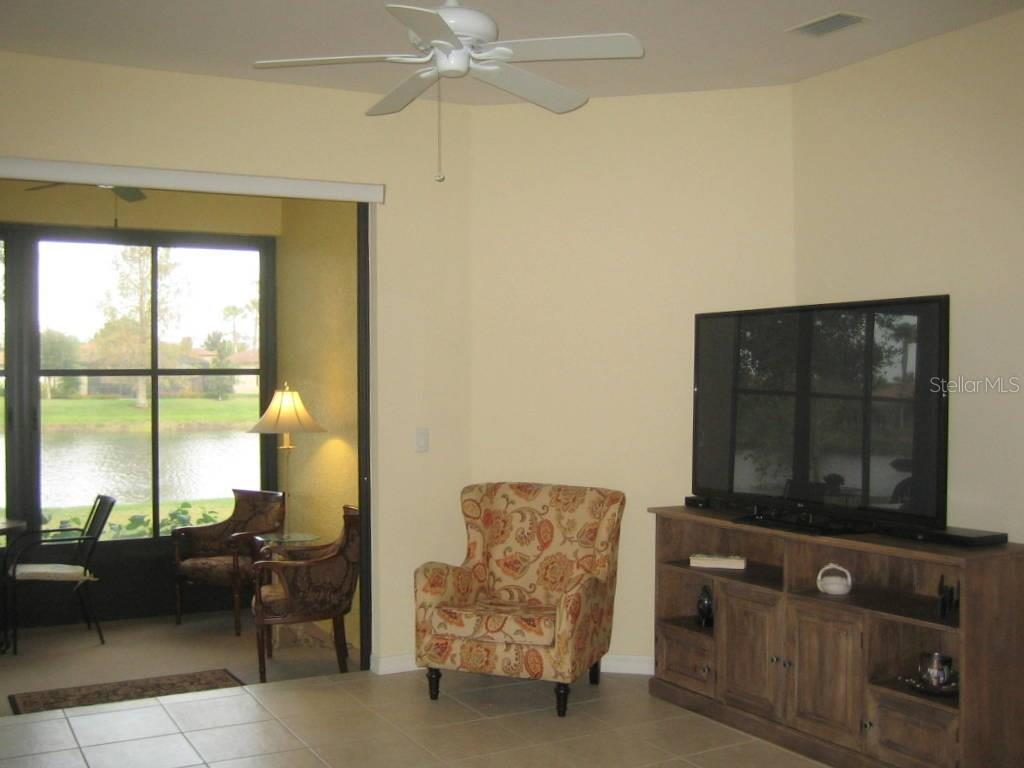 Great room sliders lead to closed in patio - Villa for sale at 1445 Maseno Dr, Venice, FL 34292 - MLS Number is N5916837