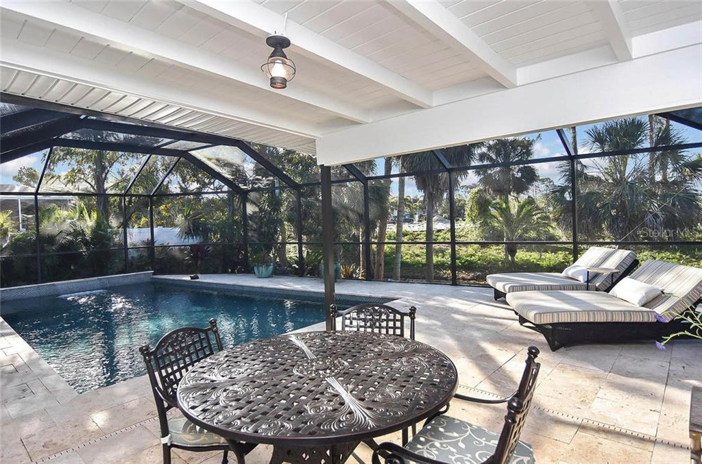 2-year old pool with travertine spacious decking. - Single Family Home for sale at 405 Sunset Dr, Venice, FL 34285 - MLS Number is N5917234