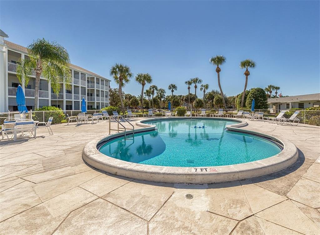 Inviting community pool to gather with friends and family. - Condo for sale at 100 The Esplanade N #4, Venice, FL 34285 - MLS Number is N6100334