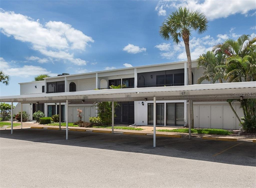 Covered parking space for Unit 67 and a lockable storage unit for your beach toys! - Condo for sale at 500 Park Blvd S #67, Venice, FL 34285 - MLS Number is N6100360