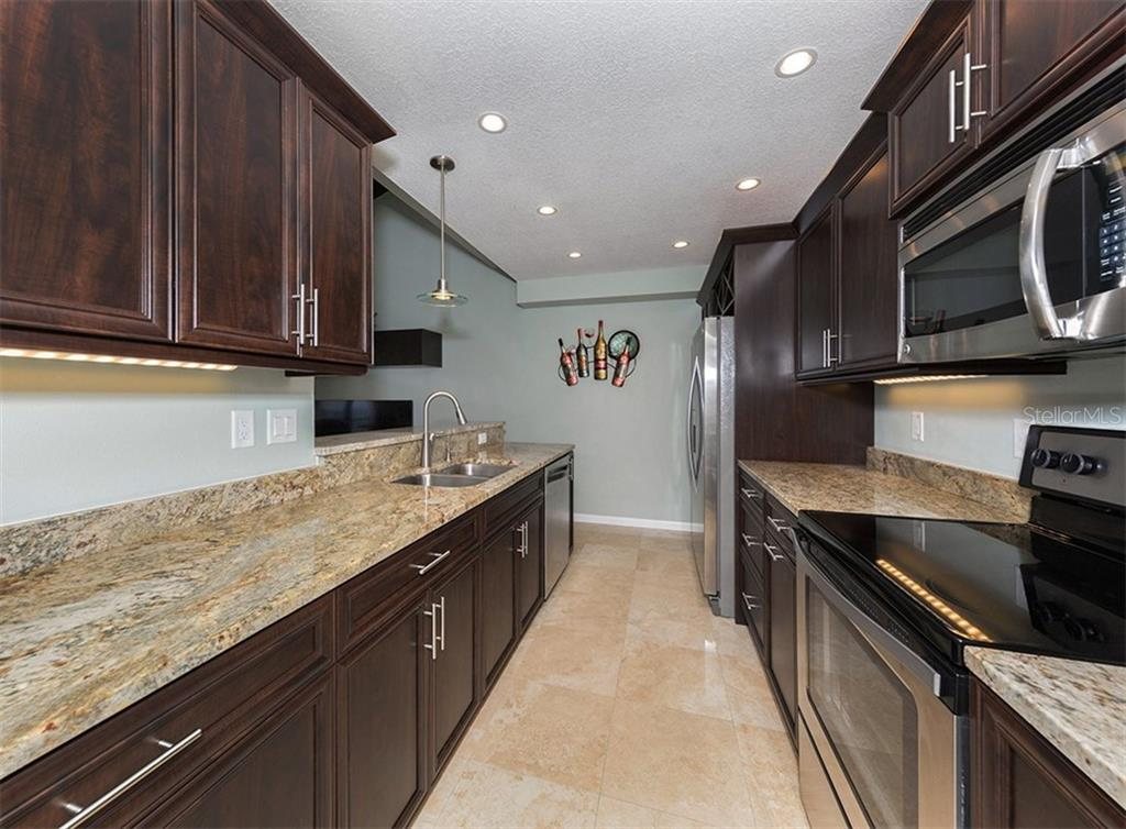 Stainless steel appliances, pot & pan and soft close cabinetry, under-mount lighting and a built in wine rack. - Condo for sale at 500 Park Blvd S #67, Venice, FL 34285 - MLS Number is N6100360
