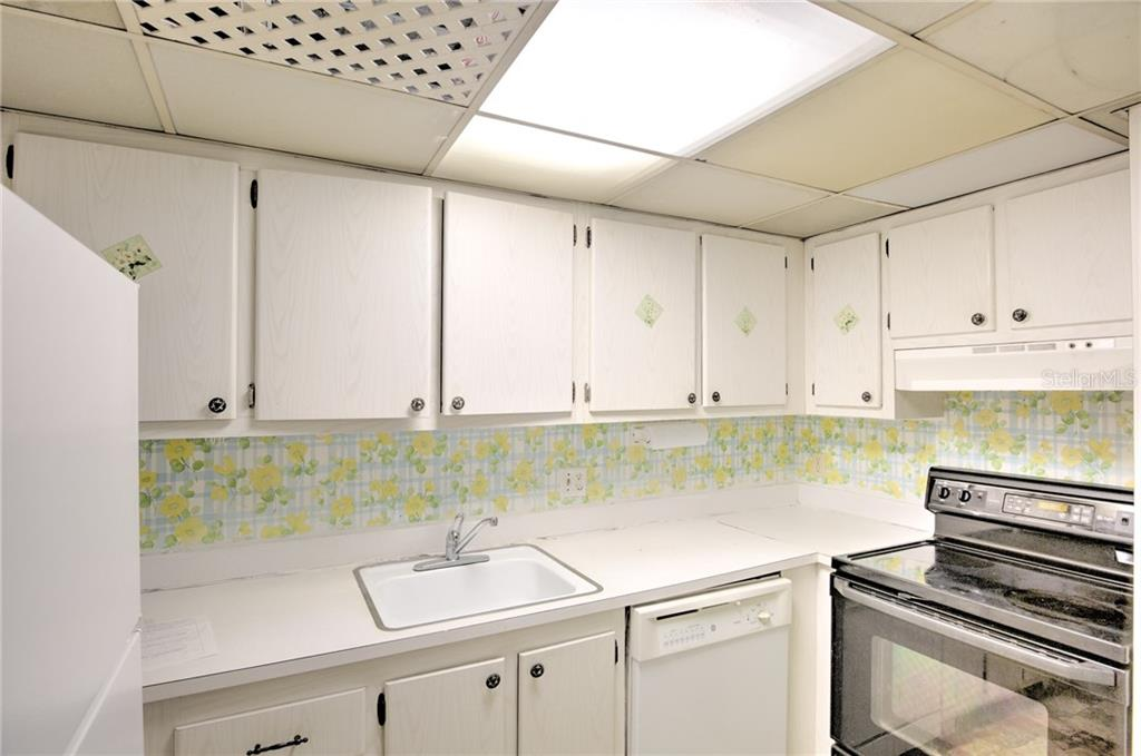 Kitchen - Condo for sale at 519 Albee Farm Rd #117, Venice, FL 34285 - MLS Number is N6100461