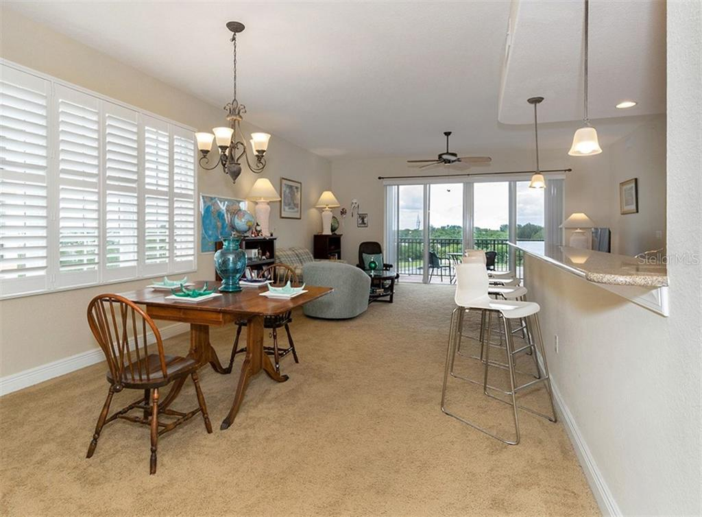 Dining area to living room - Condo for sale at 167 Tampa Ave E #612, Venice, FL 34285 - MLS Number is N6100834