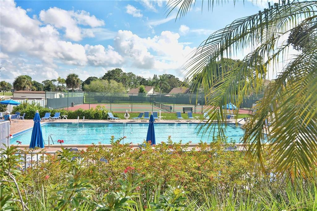 Community pool/tennis courts - Condo for sale at 654 Bird Bay Dr E #201, Venice, FL 34285 - MLS Number is N6101101