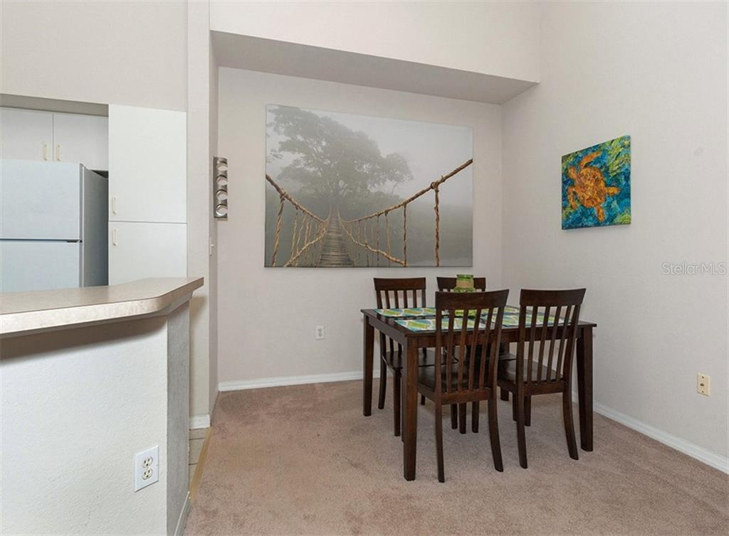 Dining room - Condo for sale at 4106 Central Sarasota Pkwy #1028, Sarasota, FL 34238 - MLS Number is N6101168