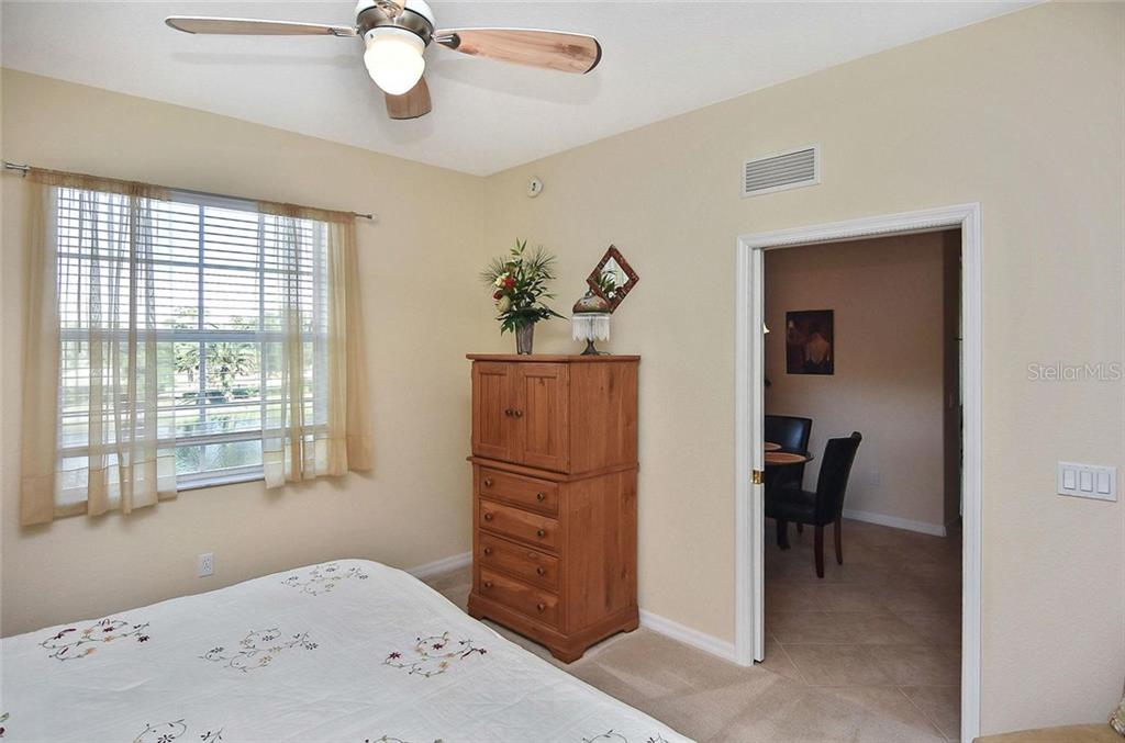 Master bedroom to dining room/kitchen - Condo for sale at 940 Cooper St #202, Venice, FL 34285 - MLS Number is N6101184