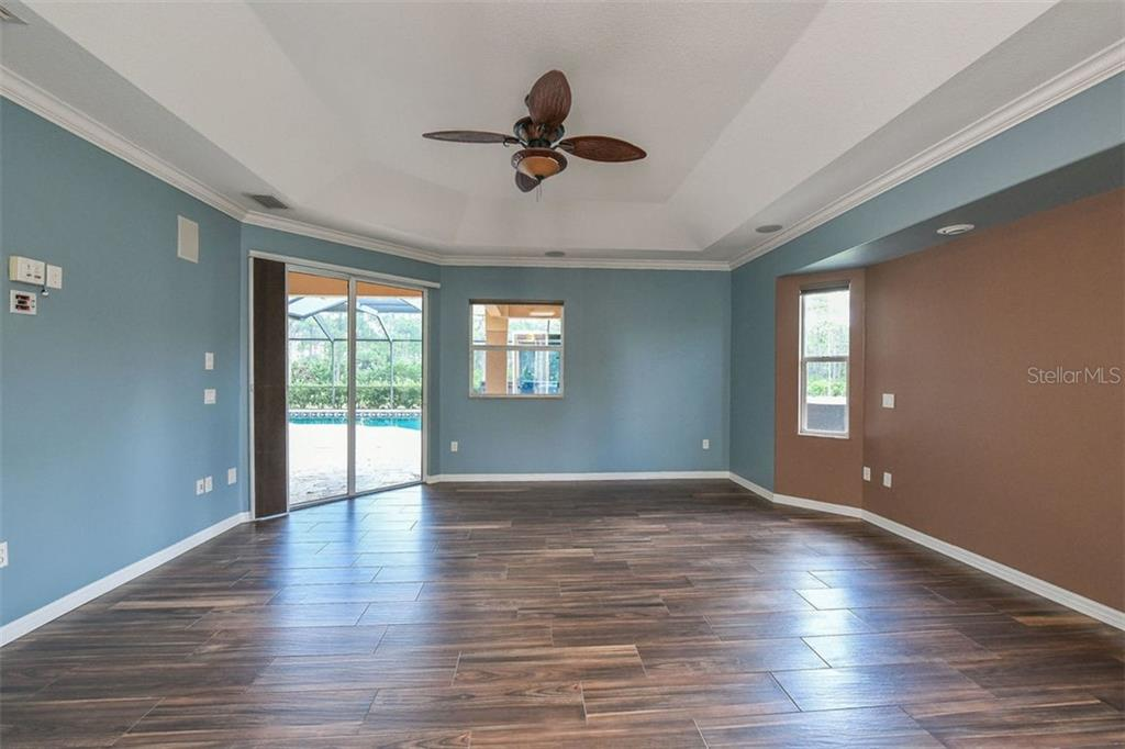 Family room to kitchen - Single Family Home for sale at 9150 Deer Ct, Venice, FL 34293 - MLS Number is N6101408