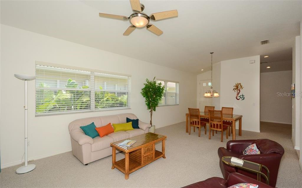Great room, dining area to foyer - Villa for sale at 313 Auburn Woods Cir, Venice, FL 34292 - MLS Number is N6101432