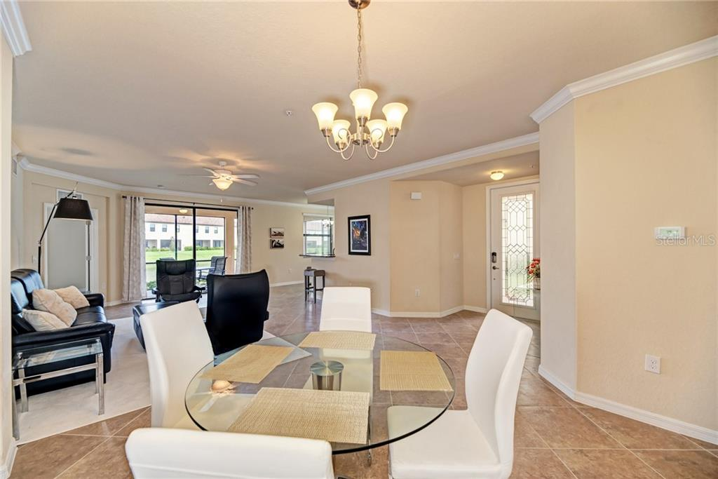 Dining to living room and breakfast bar. - Condo for sale at 20200 Ragazza Cir #102, Venice, FL 34293 - MLS Number is N6101798