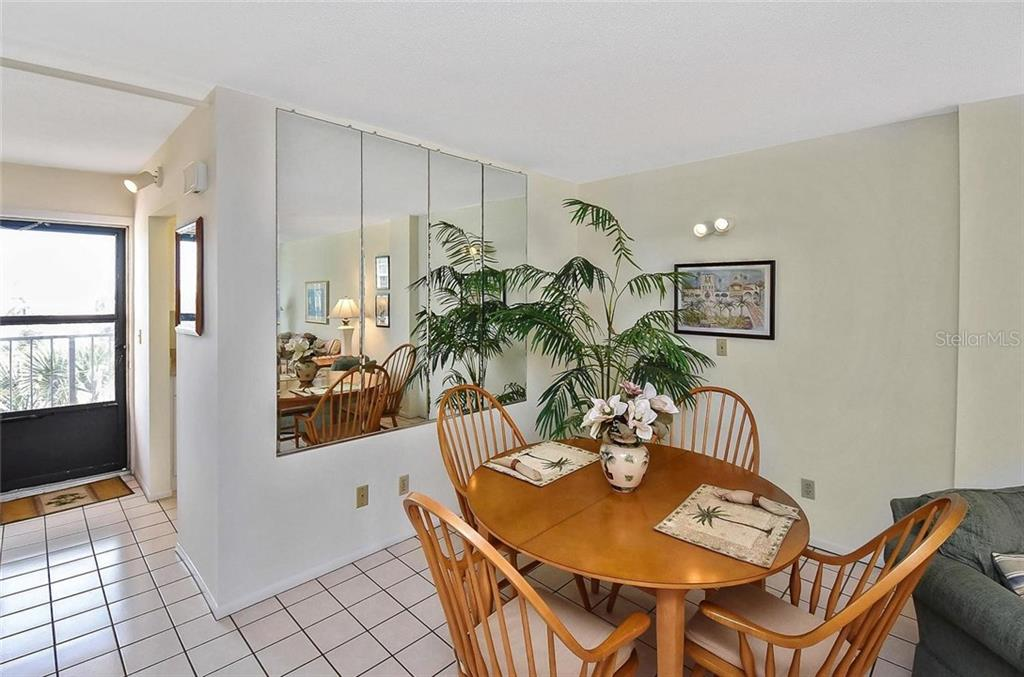 Dining room to foyer - Condo for sale at 232 Saint Augustine Ave #405, Venice, FL 34285 - MLS Number is N6101830