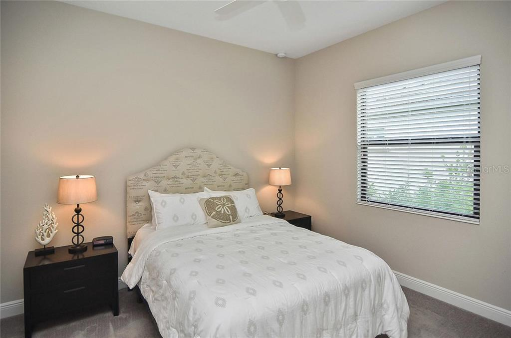 Bedroom 2 - Single Family Home for sale at 21220 St Petersburg Dr, Venice, FL 34293 - MLS Number is N6101838