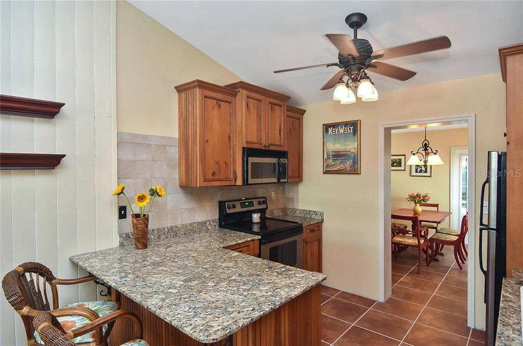 Kitchen to dining room - Single Family Home for sale at 316 Alba St E, Venice, FL 34285 - MLS Number is N6102095