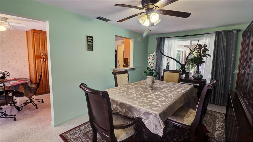 Formal Dining room with pass through to the just over the sink. Venice FL 3 bedroom - Single Family Home for sale at 401 Shamrock Blvd, Venice, FL 34293 - MLS Number is N6102109