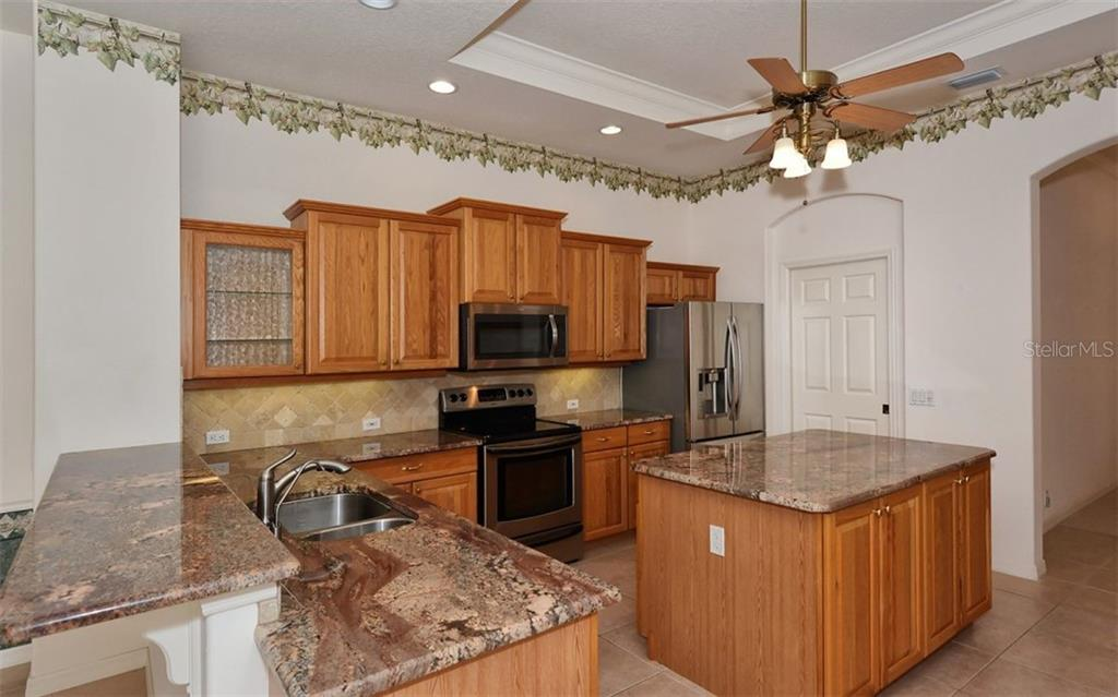 Kitchen - Single Family Home for sale at 969 Chickadee Dr, Venice, FL 34285 - MLS Number is N6102722