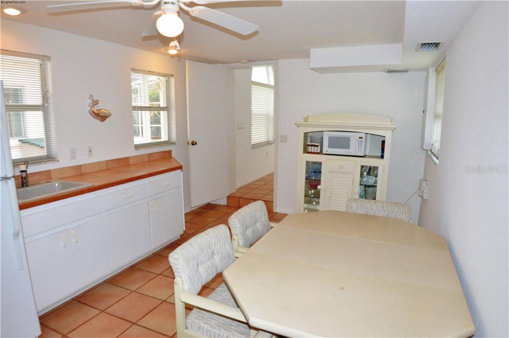 In-law suite kitchenette/dining area - Single Family Home for sale at 609 Armada Rd N, Venice, FL 34285 - MLS Number is N6102952