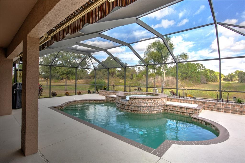 Other side of pool and lanai - Single Family Home for sale at 6612 Deer Run Rd, North Port, FL 34291 - MLS Number is N6103231