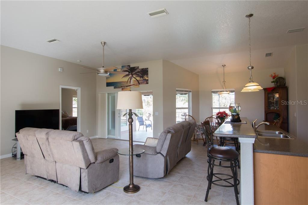Great room with eat at island/bar - Single Family Home for sale at 6612 Deer Run Rd, North Port, FL 34291 - MLS Number is N6103231