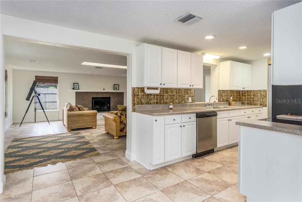 from front room/dining to kitchen and family room. - Single Family Home for sale at 3656 Clematis Rd, Venice, FL 34293 - MLS Number is N6103558