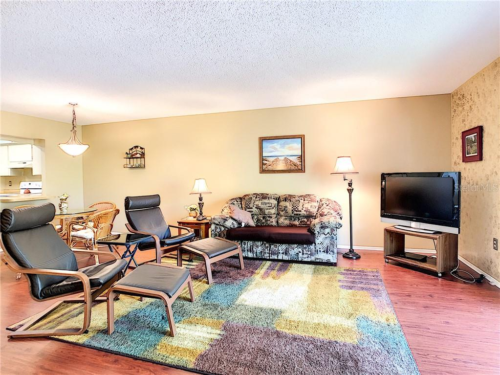 Living and dining room - Condo for sale at 211 Rubens Dr #h, Nokomis, FL 34275 - MLS Number is N6103629