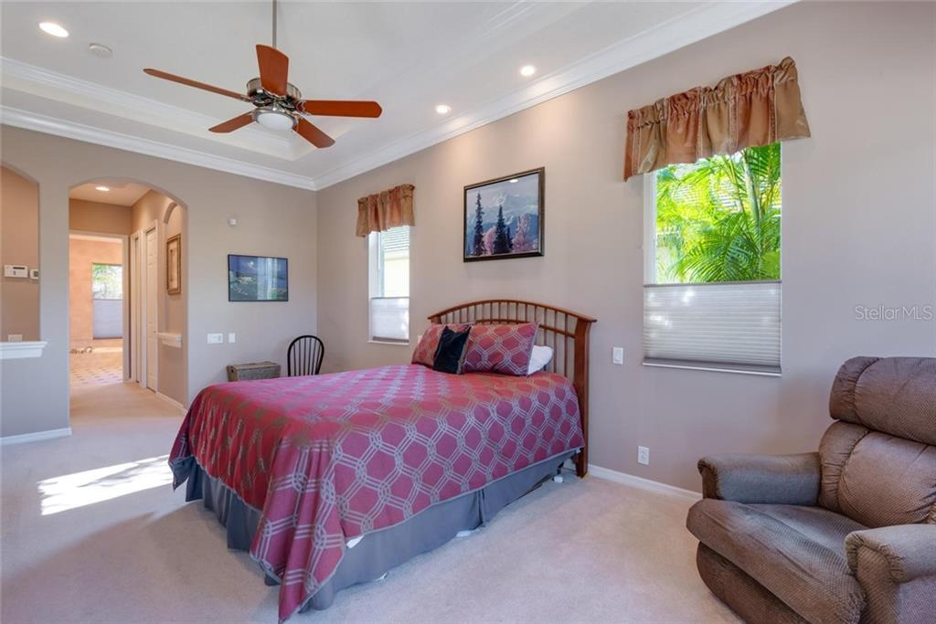 Master bedroom to master bath, hallway contains two walk-in closets with built-ins - Single Family Home for sale at 821 Adonis Pl, Venice, FL 34292 - MLS Number is N6104303