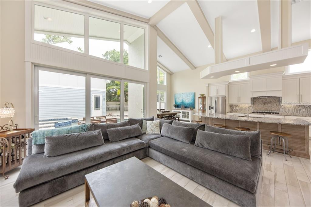 Floor to ceiling windows allowing plenty of natural light into the home - Single Family Home for sale at 1716 Arlington St, Sarasota, FL 34239 - MLS Number is N6104891