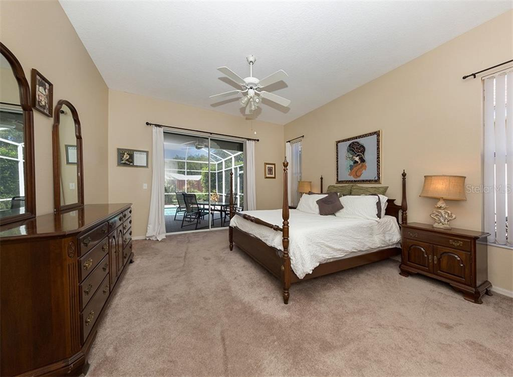 Master bedroom with sliders to lanai/pool - Single Family Home for sale at 129 Wayforest Dr, Venice, FL 34292 - MLS Number is N6105216