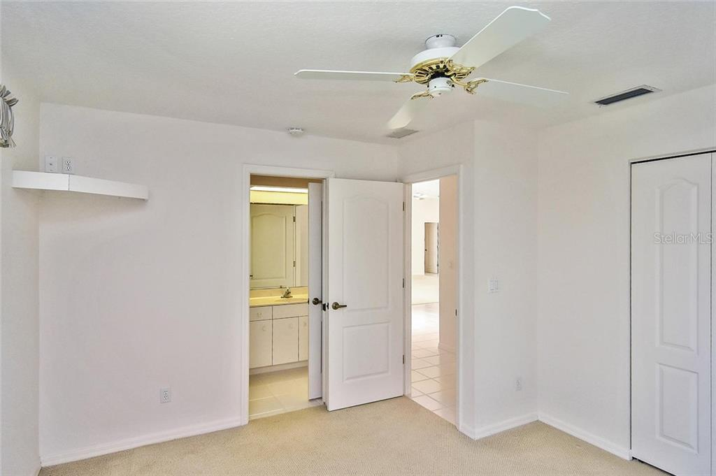 Bedroom to bathroom - Single Family Home for sale at 2232 E Village Cir, Venice, FL 34293 - MLS Number is N6105697