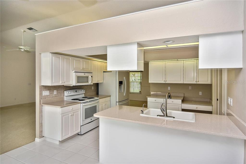 Kitchen - Single Family Home for sale at 2232 E Village Cir, Venice, FL 34293 - MLS Number is N6105697