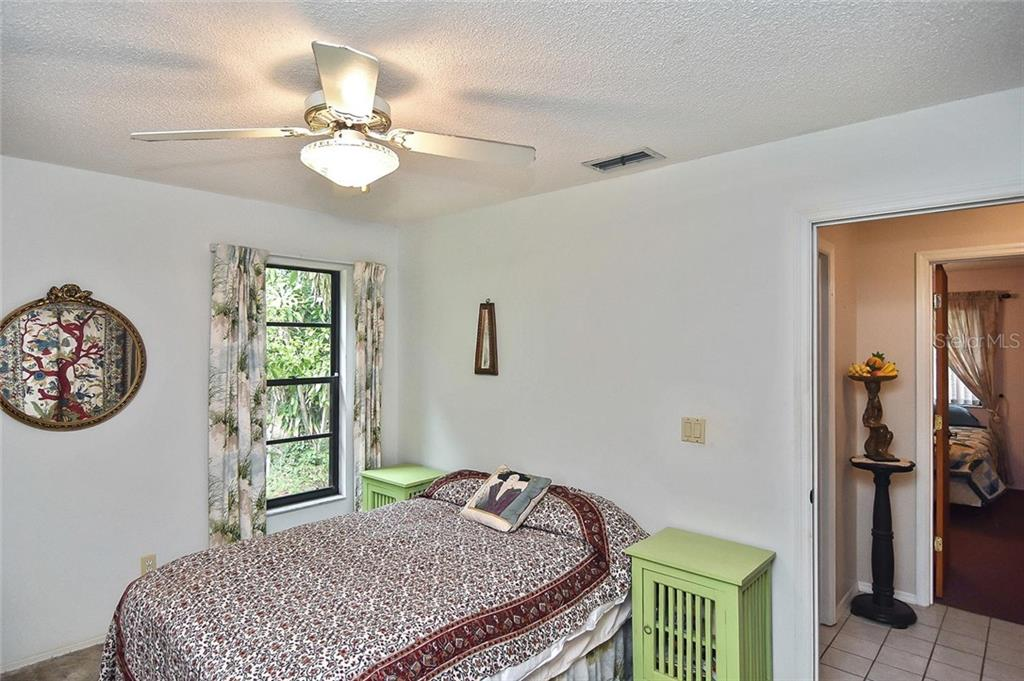 Bedroom 2 - Single Family Home for sale at 125 Palm Ave E, Nokomis, FL 34275 - MLS Number is N6105973