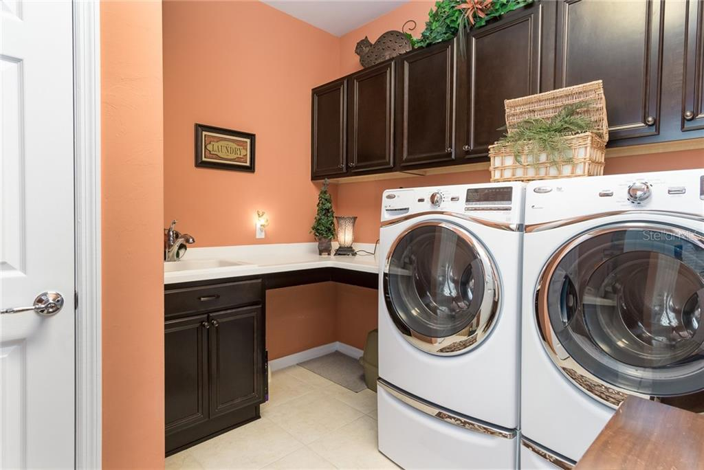 Dedicated Laundry Room - Single Family Home for sale at 19251 Jalisca St, Venice, FL 34293 - MLS Number is N6106100