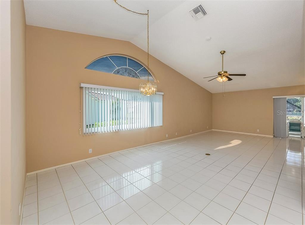 Dining room, living room - Single Family Home for sale at 4822 Limetree Ln, Venice, FL 34293 - MLS Number is N6106780