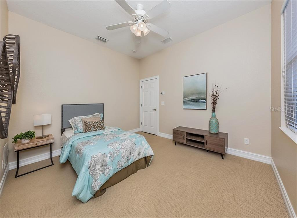 Guest bedroom. - Single Family Home for sale at 262 Pesaro Dr, North Venice, FL 34275 - MLS Number is N6107589