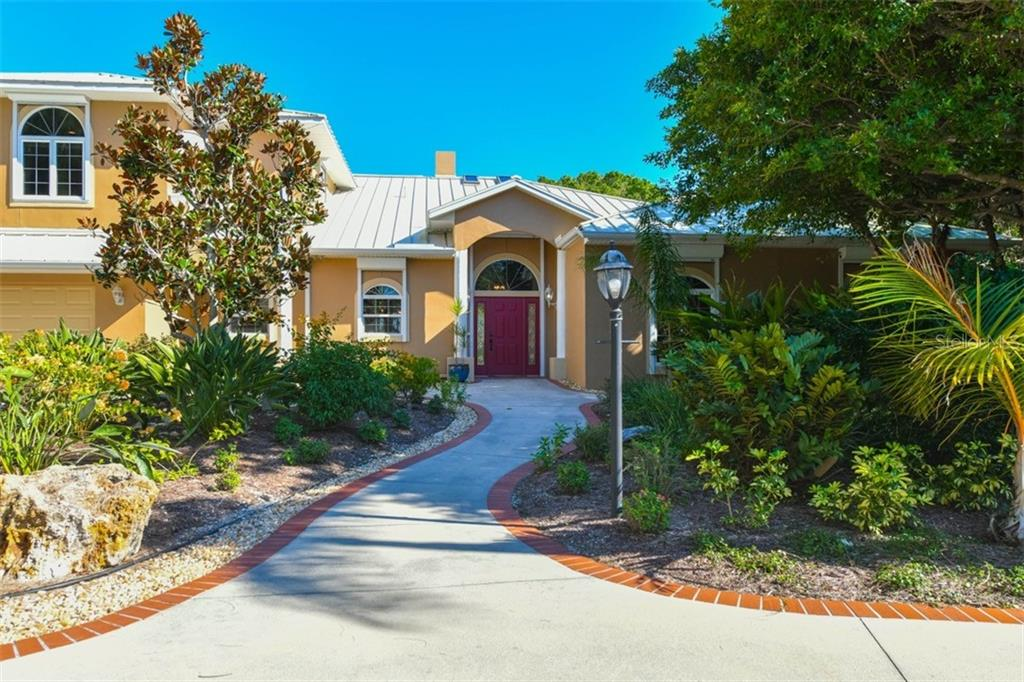 Front door - Single Family Home for sale at 7785 Manasota Key Rd, Englewood, FL 34223 - MLS Number is N6107786