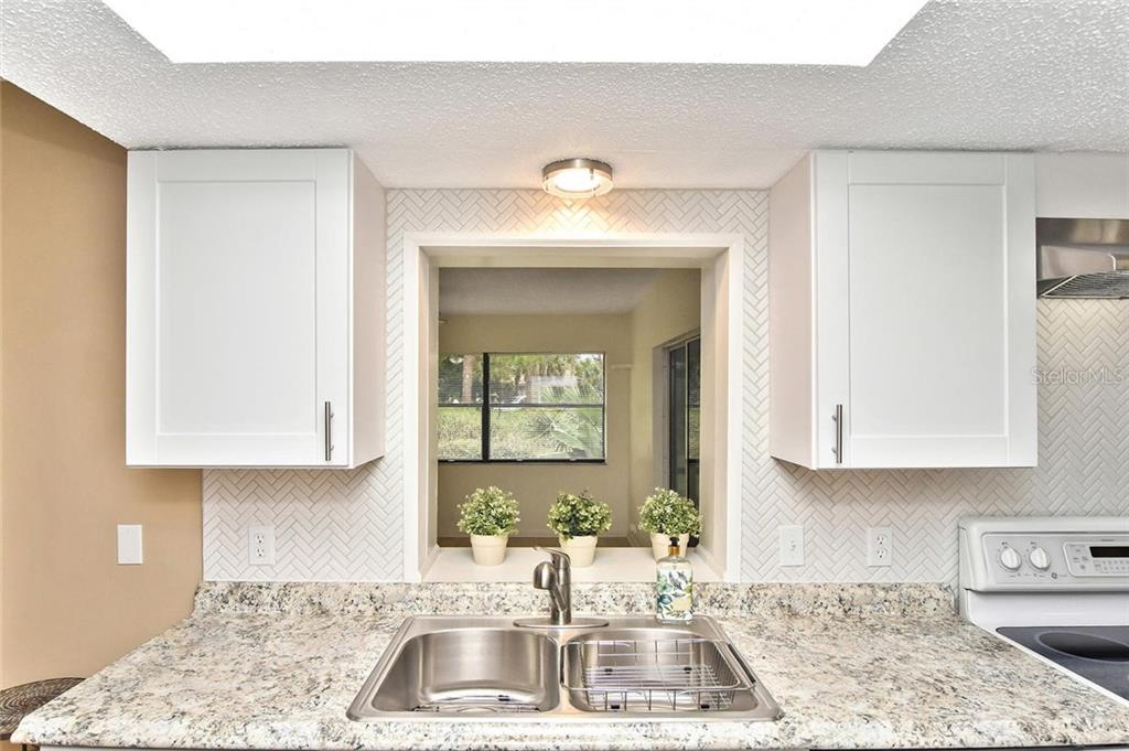 Kitchen - Single Family Home for sale at 5681 Hale Rd, Venice, FL 34293 - MLS Number is N6107822