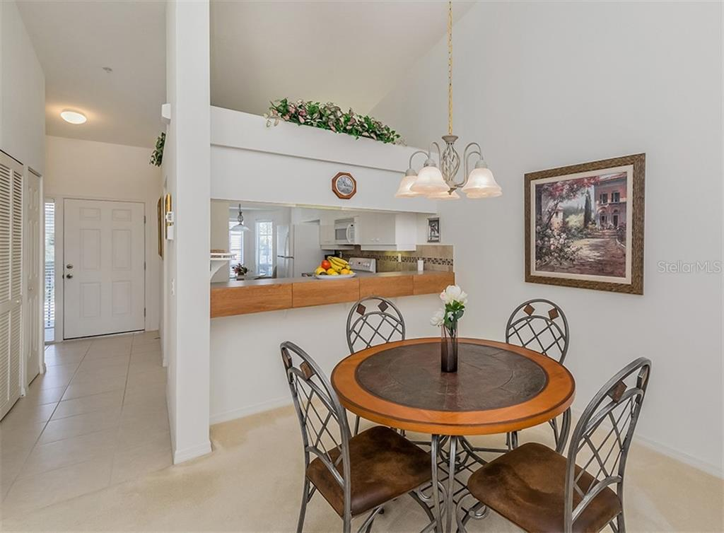 Dining room to kitchen and foyer - Condo for sale at 891 Norwalk Dr #205, Venice, FL 34292 - MLS Number is N6108169