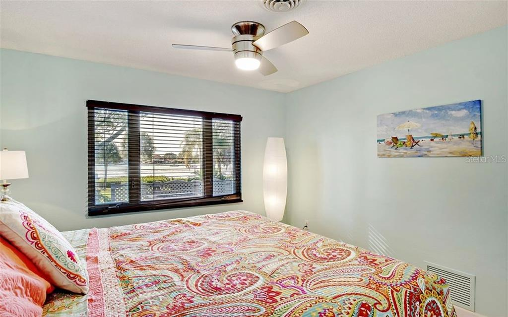 Guest bedroom 1 w/ views of the ICW - Single Family Home for sale at 925 Bayshore Rd, Nokomis, FL 34275 - MLS Number is N6108586